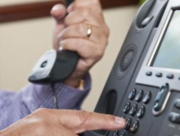 Telephone calls alleging fake arrest warrants used to scam money