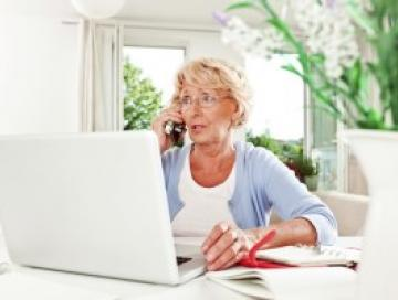 Woman looking concerned on laptop